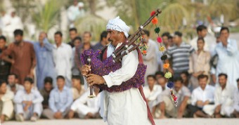 Amusing spectators with traditional folklore tunes.-Photo by Kamal Kassim