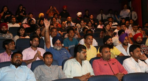 Labourers enjoying the movie