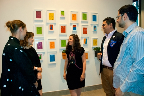 Artist Mira Mortada with guests at opening of exhibition at Rove Healthcare City.-supplied picture
